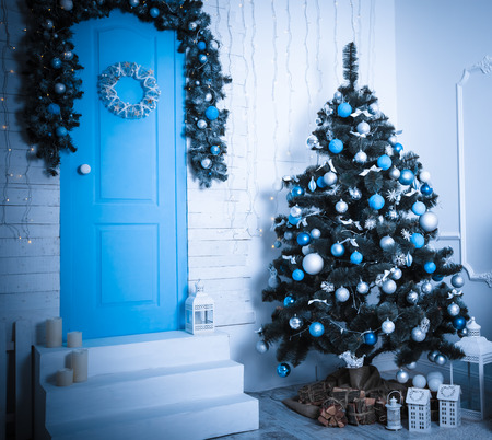hearthside: Christmas living room. Blue toned Stock Photo
