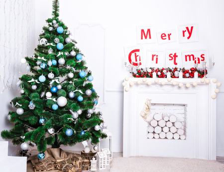 hearthside: Beautiful Christmas living room with Christmas tree and fireplace Stock Photo