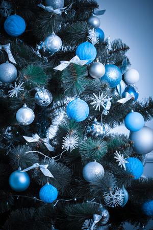 hearthside: Christmas living room with Christmas Tree. blue tone