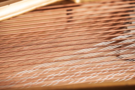 classical mechanics: Close up image of interior of grand piano showing strings and structure Stock Photo