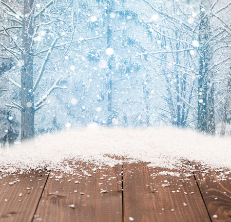 snow scene: Beautiful winter christmas background with wooden desk