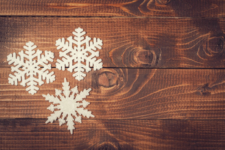 dark backgrounds: Snowflakes border on grunge wooden background. Winter holidays concept Stock Photo