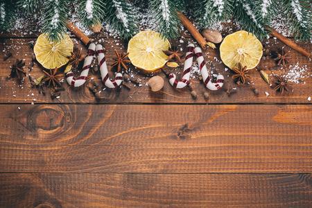 christmas decor: Christmas food decor and fir tree branch on wooden table Stock Photo