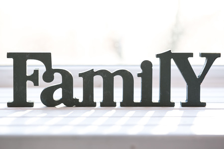 family units: Beautiful background with the words Family, mothers day or fathers day. The idea for postcards