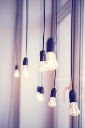festoon: iful festoon light bulb hanging at the window. Lighting decor Stock Photo