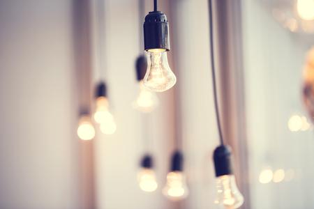 festoon: iful festoon light bulb hanging at the window. Lighting decor Stock Photo