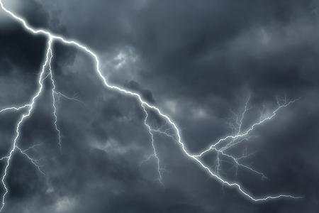 streak lightning: Lightning strike on the dark cloudy sky