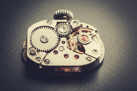 wrist watch: mechanism antique vintage wrist watch beautiful original black and metallic background Stock Photo