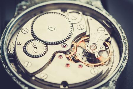 mechanism antique vintage wrist watch beautiful original black and metallic background Stock Photo
