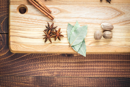 variability: Beautiful colorful spices on bright kitchen Board on old wooden brown table. Free space for your text Stock Photo