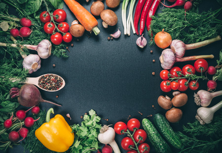 organic peppers sign: the frame of different vegetables on vintage table with free space for text Stock Photo