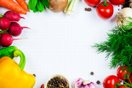 the frame of different vegetables and mushrooms with a white sheet of paper on the old brown boards with free space Stock Photo