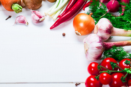 organic peppers sign: the frame of different vegetables and mushrooms on the white boards with free space for text Stock Photo
