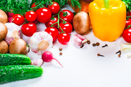 savory: the frame of different vegetables and mushrooms on the white boards with free space for text Stock Photo