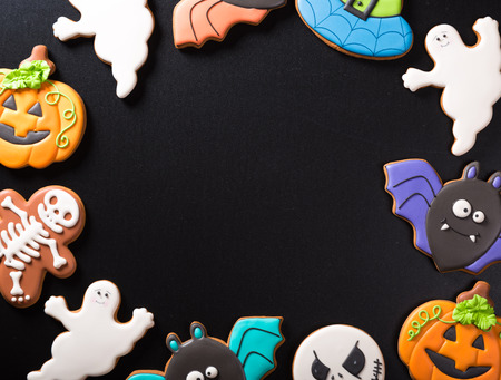 Funny delicious ginger biscuits for Halloween on the dark background. Stock Photo