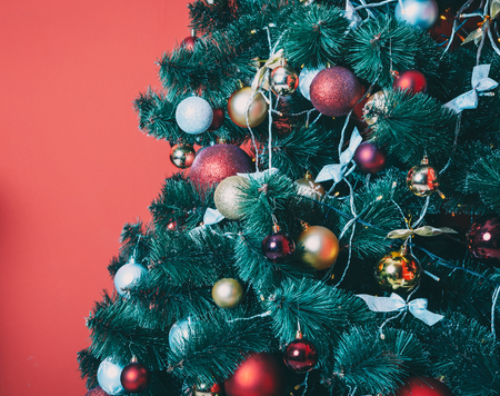 eautiful new year red room with decorated Christmas tree. The idea for postcards. Soft focus. Shallow DOF Stock Photo