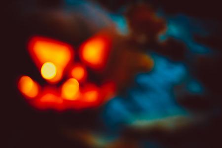 Halloween night blurred background with pumpkin. Soft focus. shallow DOF