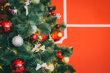 hearthside: Beautiful new year red room with decorated Christmas tree. The idea for postcards. Soft focus. Shallow DOF