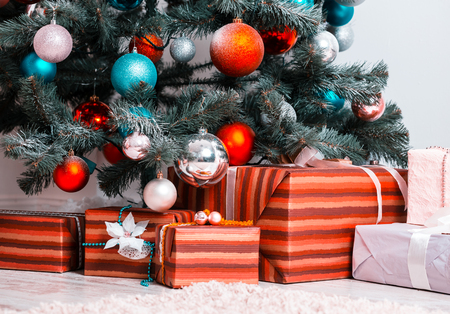 Beautiful Christmas Living Room with decorated Christmas tree and gifts. The idea for postcards.
