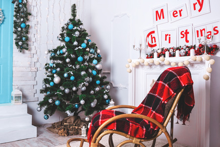 hearthside: Beautiful Christmas Living Room with decorated Christmas tree, gifts and fireplace. The idea for postcards