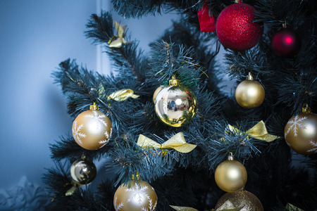 Beautiful background decorated Christmas tree with toy balls and garlands.The idea for postcards. Soft focus. Shallow DOF. blue tones Stock Photo