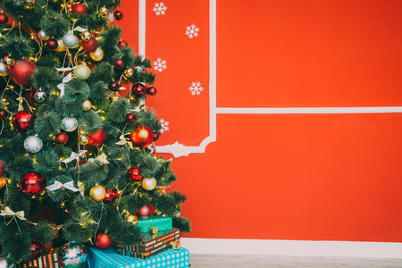 indoor background: Beautiful new year room with decorated Christmas tree and gifts. The idea for postcards. Soft focus. Shallow DOF