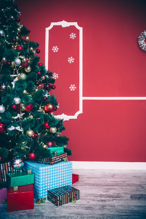 hearthside: Christmas living room with Christmas tree and gifts under it
