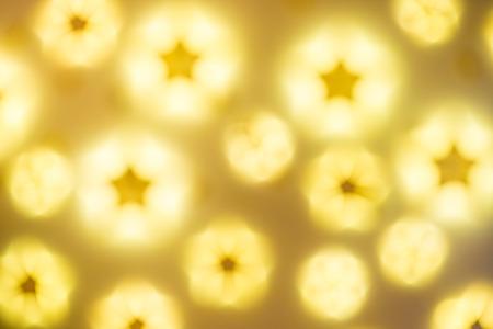 glitz: Defocused golden abstract Christmas Glitter Lights stars Background Stock Photo