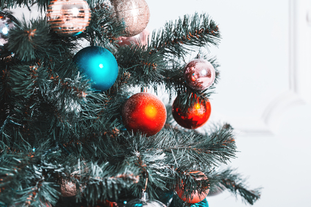 Beautiful background decorated Christmas tree with toy balls and garlands.The idea for postcards. Soft focus. Shallow DOF