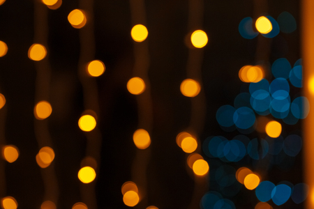 Closeup of Christmas-tree background in the living room of the house with glowing stars on the wall Stock Photo