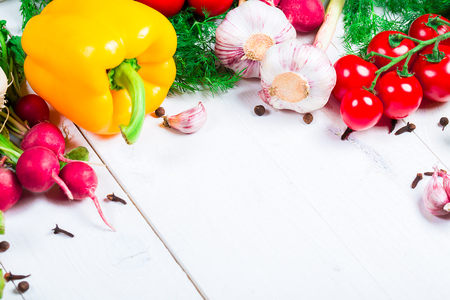 Beautiful background healthy organic eating. Studio photography the frame of different vegetables and spices on the white boards with free space for you text.