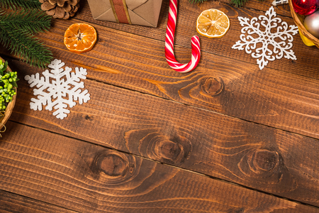 Christmas background with decor and fir tree branch on wooden table. Top view, with free space for you text Stock Photo