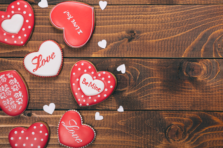 spicecake: Heart-shaped biscuits for Valentines Day. Gingerbread Valentine on wooden background. Free space for your text