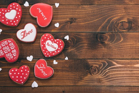 Heart-shaped biscuits for Valentines Day. Gingerbread Valentine on wooden background. Free space for your text