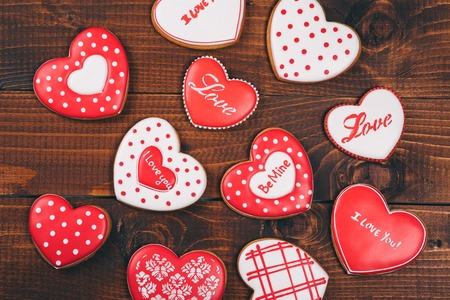 spicecake: Heart-shaped biscuits for Valentines Day. Gingerbread Valentine on wooden background Stock Photo