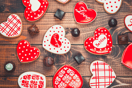 spicecake: Heart-shaped biscuits for Valentines Day. Gingerbread Valentine with chocolate on wooden background
