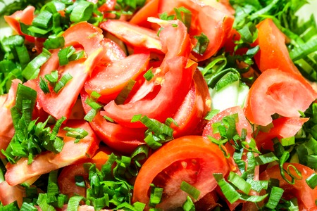 Background of tomato salad with green onions, black pepper and olive oil Stock Photo