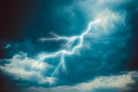 thunderhead: Lightning strike on the dark cloudy sky