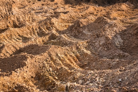 Clay and sand in the quarry. Beautiful unusual background similar to the surface of the planet Mars or the moon Stock Photo