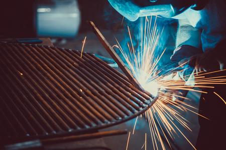 Welding Work. Erecting Technical Steel Industrial Steel Welder In Factory. Craftsman. Soft focus. Shallow DOF.