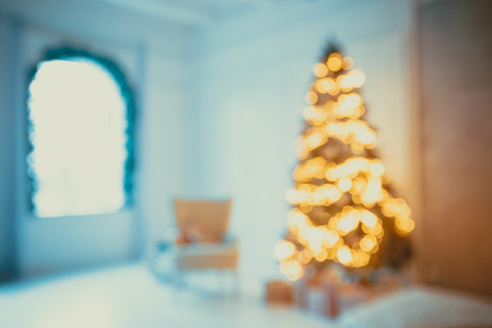 Defocused background Living room with christmas tree. Beautiful New Year decorated classic home interior. Winter background Stock Photo
