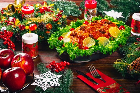 Christmas table dinner time with roasted meats decorated in Christmas style. Background thanksgiving. The concept of a family holiday, Beautiful delicious food.