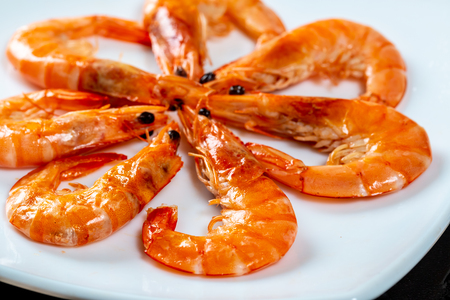 Grilled prawns close up. Royal delicious and beautiful shrimp. Flatley. Food background