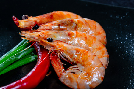 Grilled prawns with chili pepper. Royal delicious and beautiful shrimp. Flatley. Food background