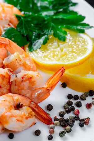 Grilled prawns with lemon and herbs. Royal delicious and beautiful shrimp. Flatley. Food background