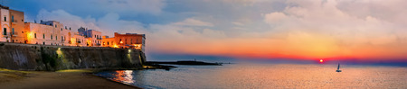 Panoramic sunset view of Gallipoli old city and sea, Apulia, Italy