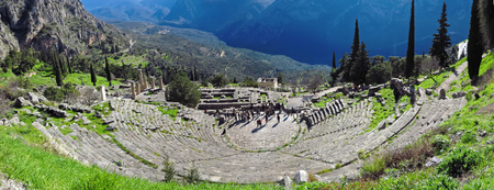 Ruins of the ancient Temple of Apollo at Delphi, overlooking the valley of Phocis, panoramic Stock Photo