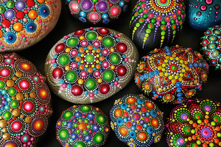 Beautiful rock mandalas painted with a brush closeup Stok Fotoğraf