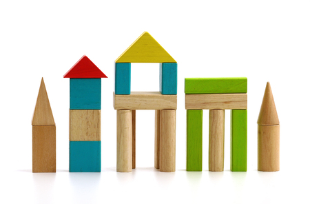 childrens wooden blocks on white background isolated