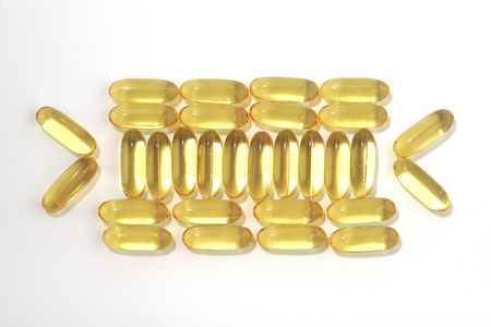 translucent fish oil capsules on a white background